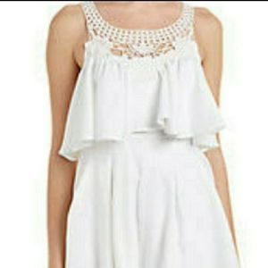 Reverse white romper with crochet details size S